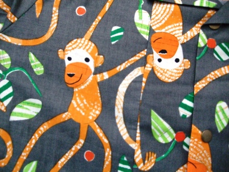 Boys shirt - orange monkeys size 7-8 years